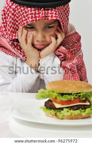 Angry Arabic kid with burger