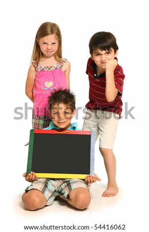 Angry boys and girl holding blank chalk board