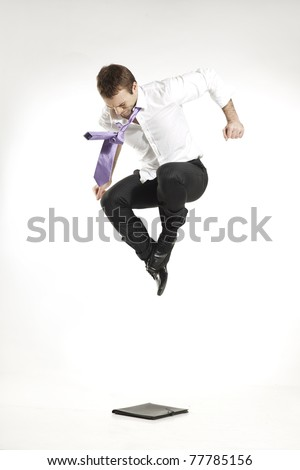 angry businessman jumping and stomping on a business portfolio