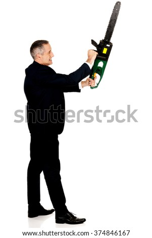 Angry businessman with chainsaw