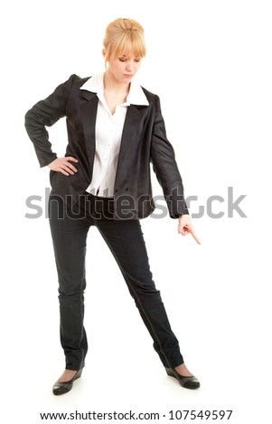 angry businesswoman pointing down, showing something, white background