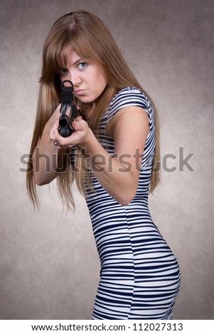 angry cute girl with gun