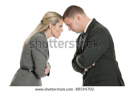 Angry male and female business people butting heads isolated on a white background