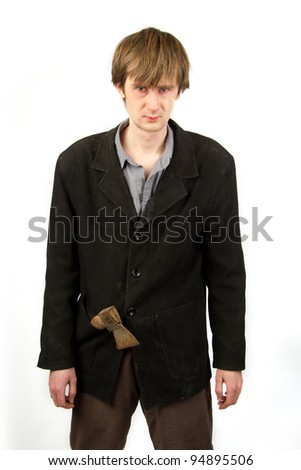 Angry man with rusty axe in the pocket of his suit