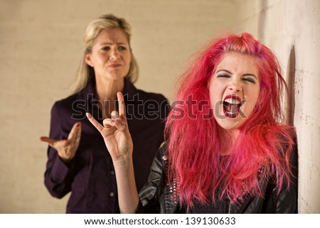 Angry parent with loud teenager with pink hair