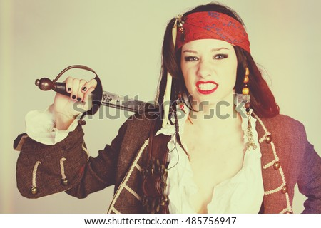 Angry pirate woman holding sword