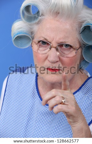 Angry woman with her hair in rollers