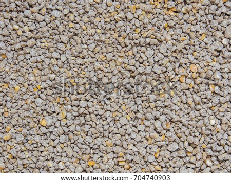 Animal feed crumble as background.