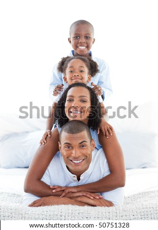 Animated family having fun lying down on bed at home