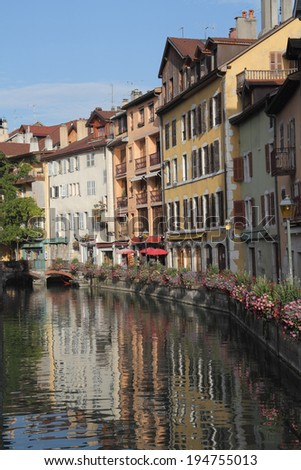 ANNECY, FRANCE - SEPTEMBER 16, 2012: The ancient city in south of France - Annecy. Homes are reflected in smooth water channel