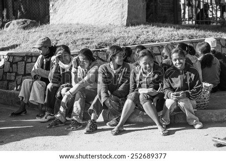 ANTANANARIVO, MADAGASCAR - JUNE 29, 2011: Unidentified Madagascar school pupils sit on the ground. People in Madagascar suffer of poverty due to the slow development of the country