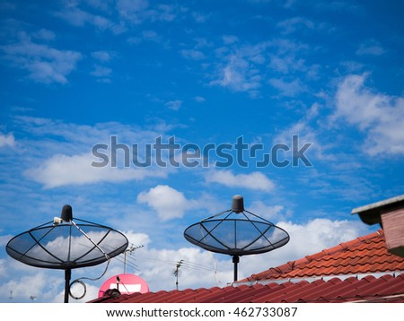 Antenna on the roof with the blue sky background