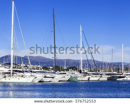 ANTIBES, FRANCE, on JANUARY 11, 2016. A view from the embankment on the yachts moored at the coast. Antibes - one of the cities of French riviera
