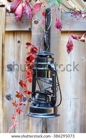 Antique black  lantern hanging on fence