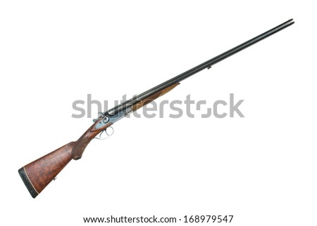 Antique hunting double-barrelled gun on a white background