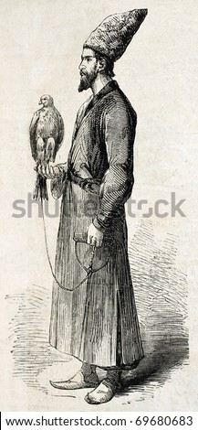 Antique illustration of a falconer with his hawk  in Isfahan, Persia. Original illustration, engraved on drawing of E. Duhousset, was published on L'Illustration, Journal Universel, Paris, 1860