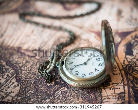 Antique pocket watch on ancient map stock photo 311945165 antique pocket watch clock on old treasure world map background gumiabroncs Choice Image