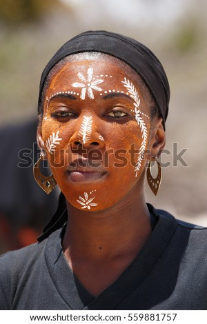ANTSIRANANA, DIEGO-SUAREZ, MADAGASCAR, OCTOBER 29.2016, Native Malagasy Sakalava ethnic girls, beauties with decorated face on the beach in Diego Suarez Bay, Madagascar, October 29. 2016
