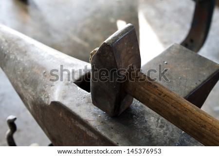 Anvil with Hammer - stock photo