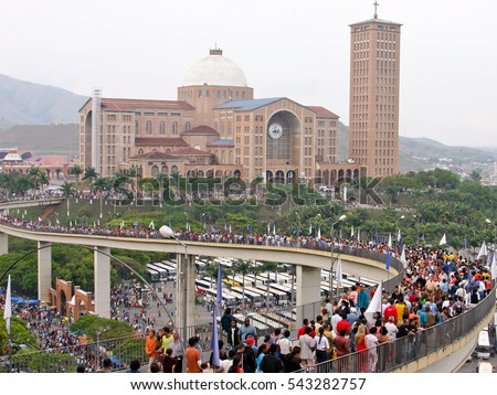 Aparecida, Brazil - October 12, 2004: Crowd of people cross the bridge to cathedral known as Basilica of Our Lady of Aparecida. October 12 is a national holiday, to celebrate the patroness of Brazil.