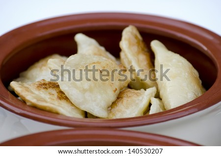 Appetizing food - dumplings in a pan close-up