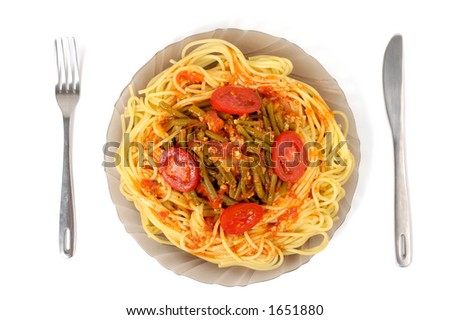 Appetizing pasta with asparagus sauce on a plate isolated on white
