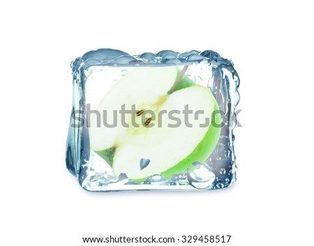 apple in ice cube isolated on white background