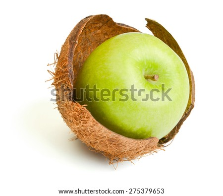 apple inside coconut shell isolated on white