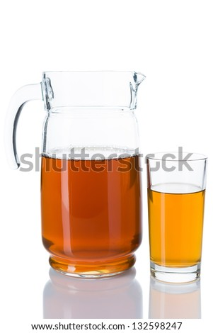 Apple juice in a jug and a glass isolated over white background
