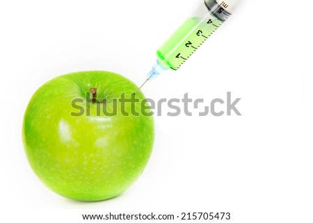 Apple with syringe needle on white background  ,therapy concept