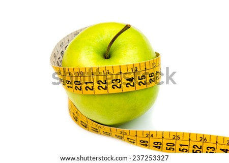 Apple with tape measure on white background