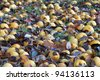 Apples and pears on the ground under the tree - stock photo