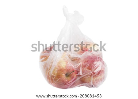 Apples in plastic bag isolated on white.
