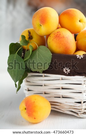 Apricots with leaves in a basket