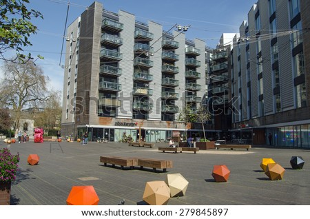 APRIL 12, 2015:  People enjoying the spring sunshine in April at Bermondsey Square in urban Southwark, South London.  The area has recently become popular with hipsters.
