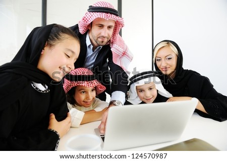 Arabic happy family working on laptop