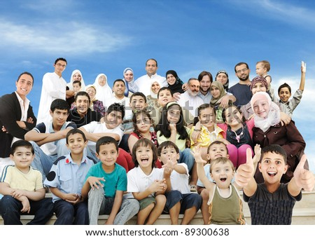 Arabic Muslim portrait of very big family group with many members, 3 generations
