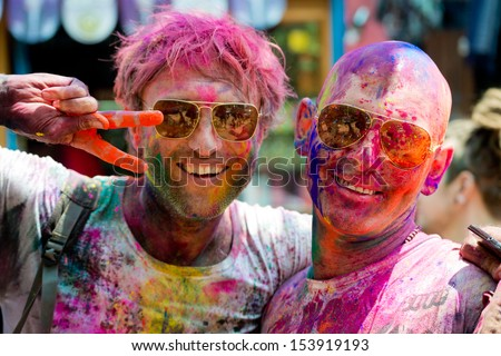 ARAMBOL, GOA - MARCH 27: Unidentified people celebrate Holi festival in Arambol Main Street, GOA, India on March 27, 2013. It's a religious spring holiday and also known as Festival of Colours.