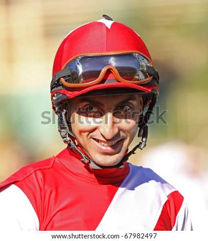 ARCADIA, CA - DEC 26: Jockey Edwin A. Maldonado waits for his mount in the walking ring at Santa Anita Park on Opening Day, Dec 26, 2010 in Arcadia, CA.