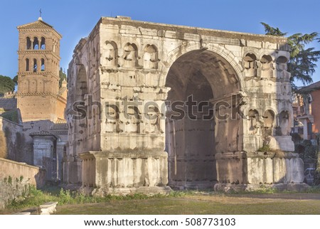Arch of Janus in the Forum Boarium with church in background, Rome, Italy