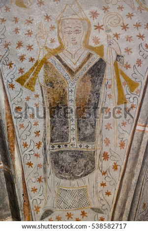 Archbishop holds a crook in his left hand and blesses with his right. Fresco in Fjelie church, Sweden, Feb 06, 2015,