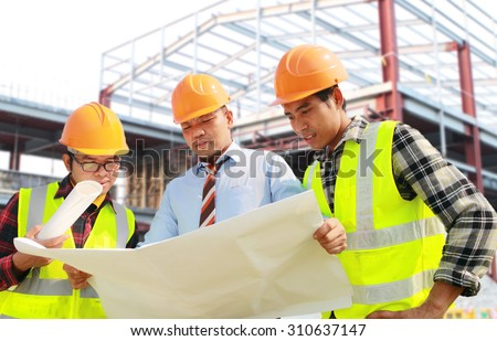 Architect and foreman construction worker discussion a plan, looking blueprint on location site