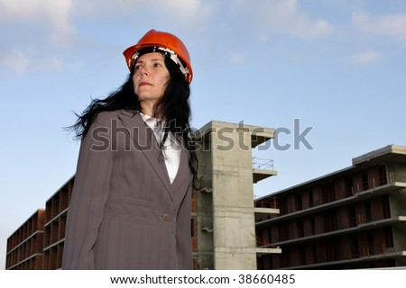 Architect standing in front of a building site.