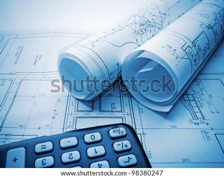 Architectural blueprints rolls and calculator