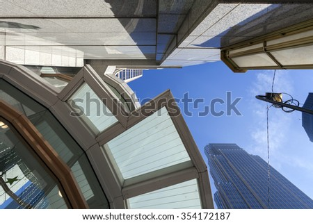 Architecture abstract. Looking up at skyscrapers and buildings in the city.