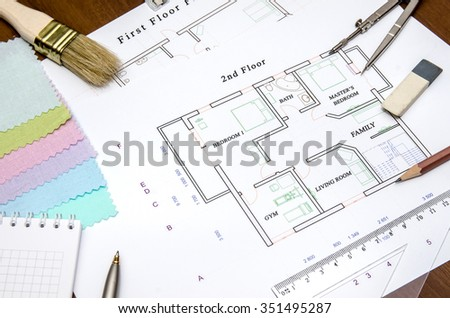 Architecture planning with color swatches and pen, rule on wooden table