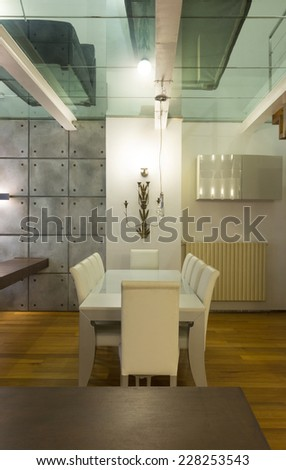 Architecture, wide loft with modern furniture, dining room