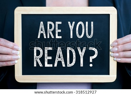 Are you ready ? - Businesswoman holding chalkboard with text