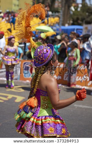 ARICA, CHILE - JANUARY 24, 2016: Morenada dancer in traditional Andean costume performing at the annual Carnaval Andino con la Fuerza del Sol in Arica, Chile.
