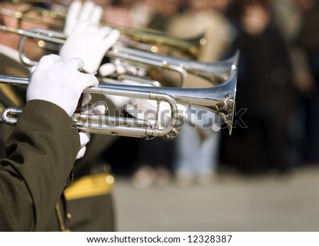 army brass band ,hands of musicians with trumpets (selective focus)